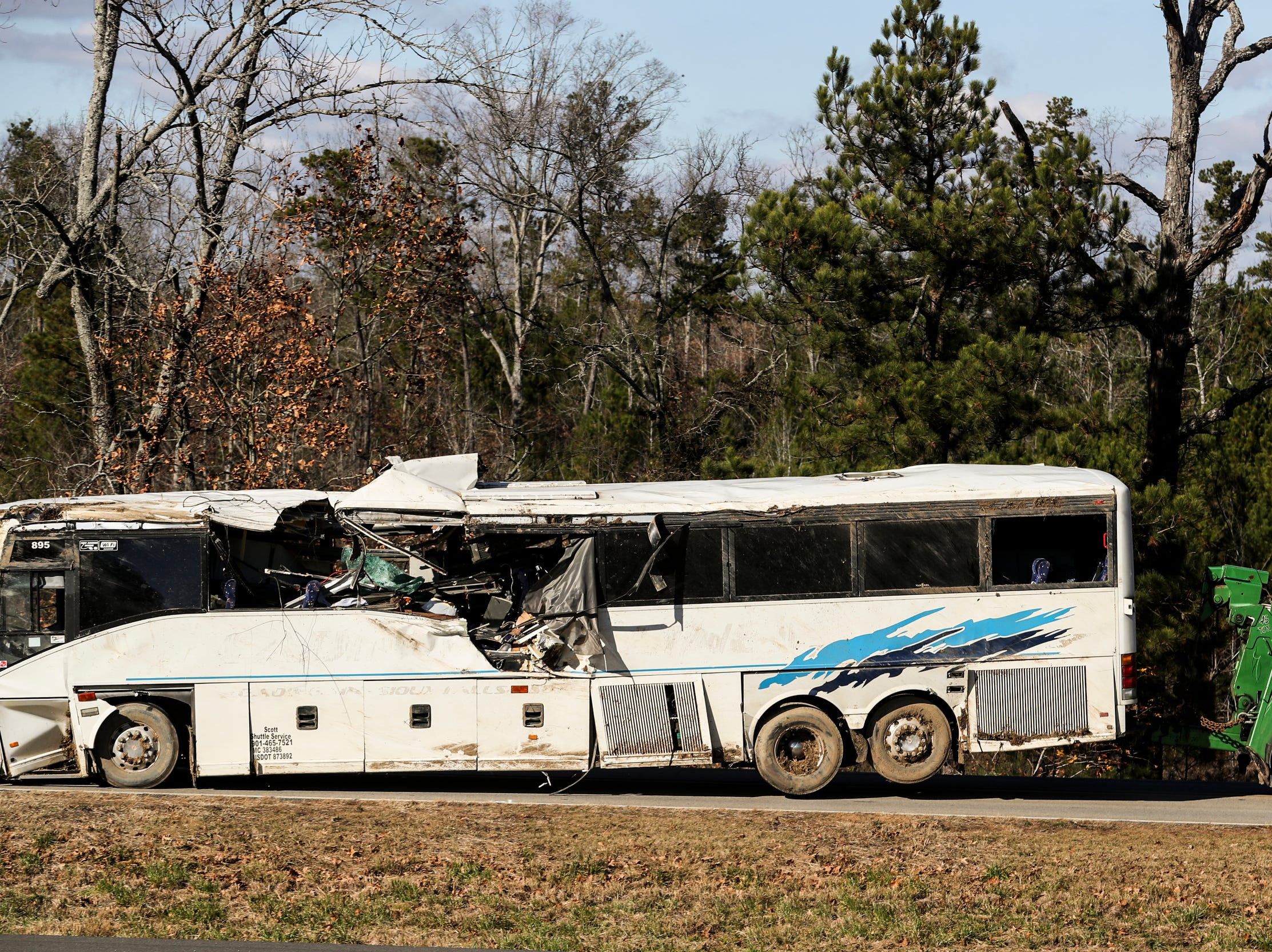 The bus that carried the football teams from Orange Mound that crashed outside Benton, Arkansas, is towed away from the scene of the accident Dec. 3, 2018.