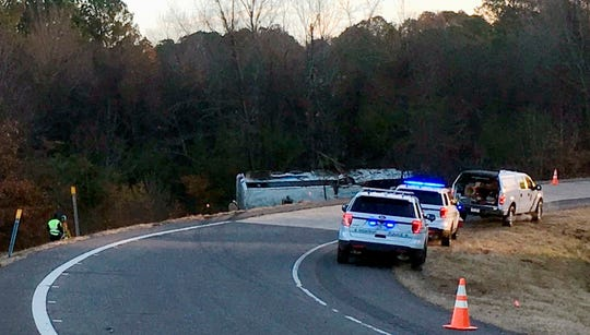 Emergency personnel work at the scene where a charter bus that was carrying a youth football team from Tennessee crashed early Monday, Dec. 3, 2018, near Benton, Ark. Arkansas State Police said the bus overturned along Interstate 30 while carrying the team from Texas to Memphis, Tenn. (Josh Snyder/The Arkansas Democrat-Gazette via AP)