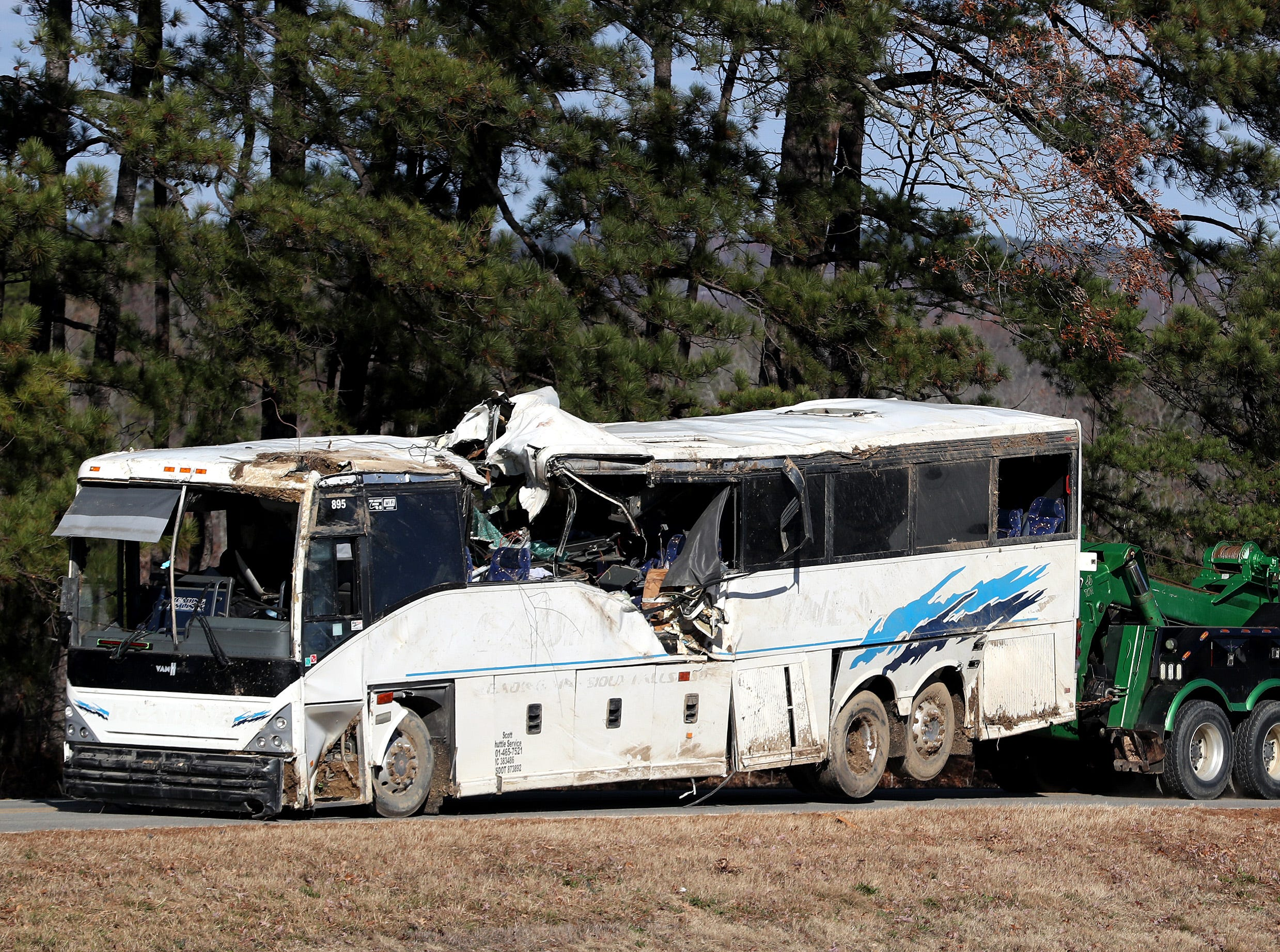 The bus that the football teams from Orange Mound that crashed outside Benton, Arkansas, is towed away from the scene of the accident Monday afternoon, Dec. 3, 2018.