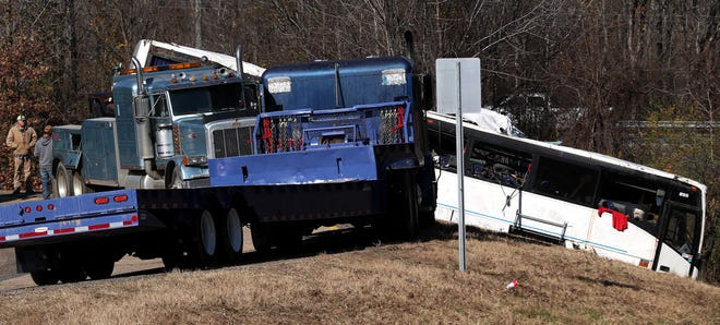 A charter bus that was carrying an Orange Mound youth football team that crashed near Benton, Arkansas, is removed from where it went off the road on I-30, Monday, Dec. 3, 2018.
