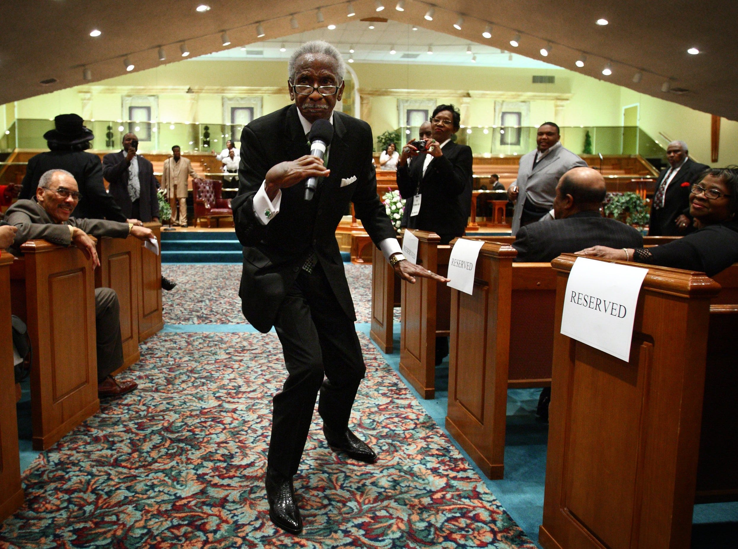 012411  B! Secondary      January 23, 2011 - Pastor Melvin Rogers struts through the isle while singing during the Super Sunday celebration at Mt. Moriah East Baptist Church in Orange Mound. The event included musical performance from local musicians and choirs along with singer Dottie People and speakers including Rev. Al Sharpton. (Mike Brown/The Commercial Appeal)