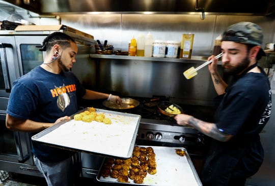 Bedrock Eats & Sweets cooks prepare meals in the downtown healthy eating restaurant.