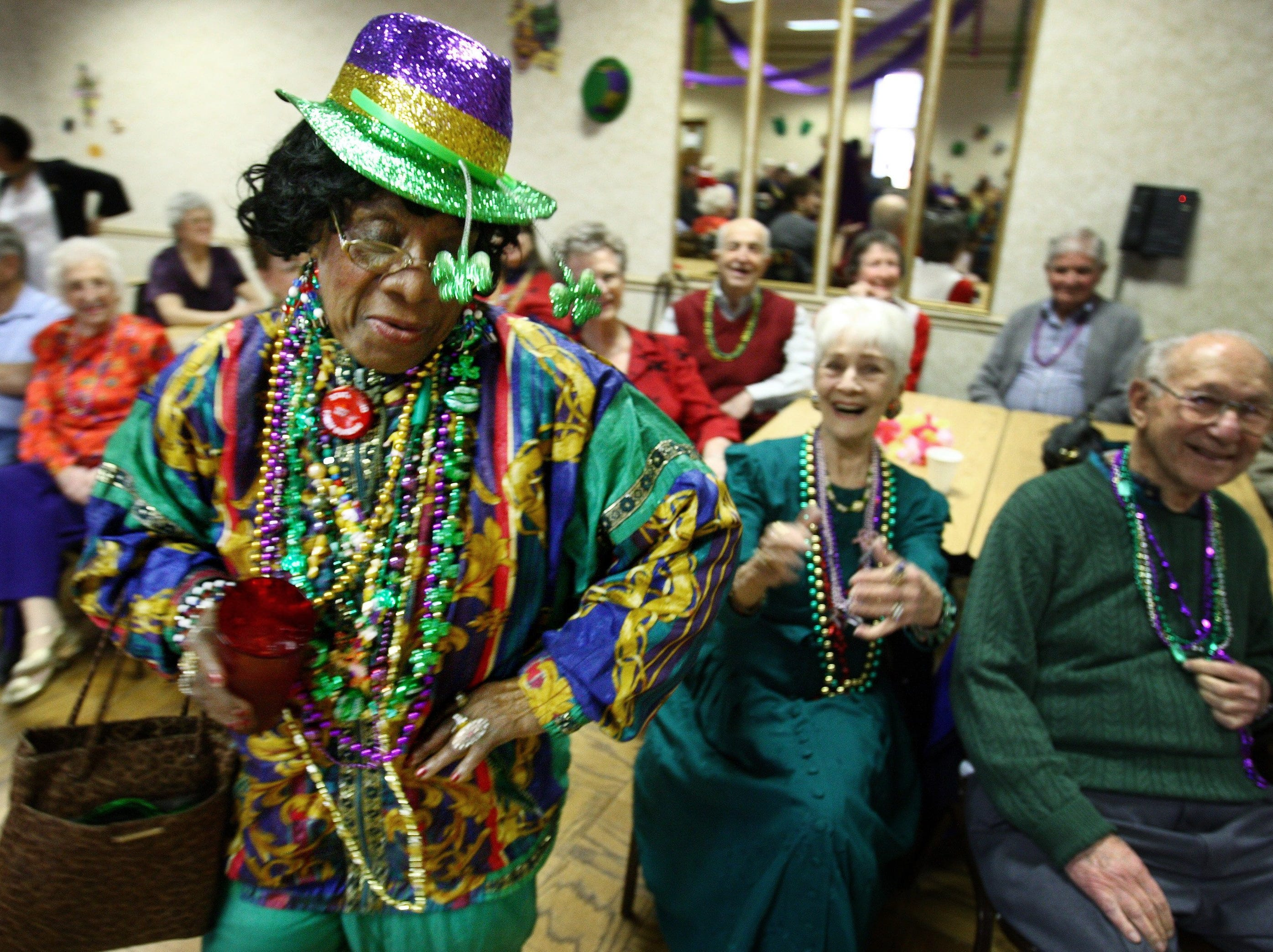 Tue 16 Feb 10 (mbmardi1) Photo by Mike Brown. Vennie McIntosh, 79, grooves to the sounds of the Jim Mahannah Band during a Mardi Gras celebration at the Frayser-Raleigh Senior Center. More than 150 seniors from the Lewis, Orange Mound and Frayser-Raleigh senior centers gathered to celebrate Fat Tuesday together with dancing and cake.