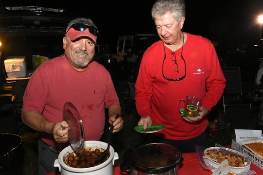 Pete Arcidiacono, left, and Keith Wohltman of the Marco Sportfishing Club show how to tailgate. Thousands turned out for the Christmas Island Style tree-lighting ceremony at Veterans' Community Park on Saturday evening.
