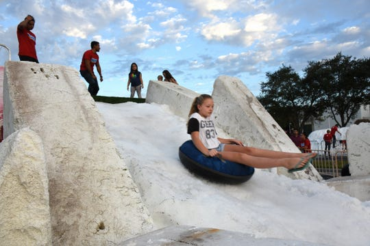 Where else can you toboggan in flipflops? Hundreds of children and their parents came out for a taste of winter at Snowfest, Saturday afternoon at Golden Gate Community Center.