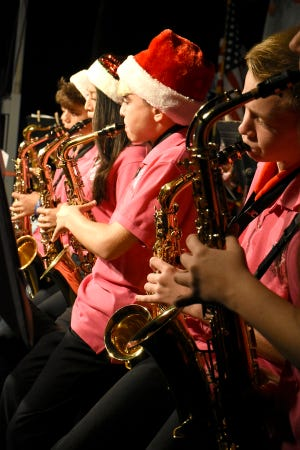 Horn players with the MICMS band perform. Thousands turned out for the Christmas Island Style tree-lighting ceremony at Veterans' Community Park on Saturday evening.