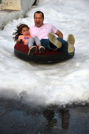 Some kids felt safer sledding with dad along for the ride. Hundreds of children and their parents came out for a taste of winter at Snowfest, Saturday afternoon at Golden Gate Community Center.