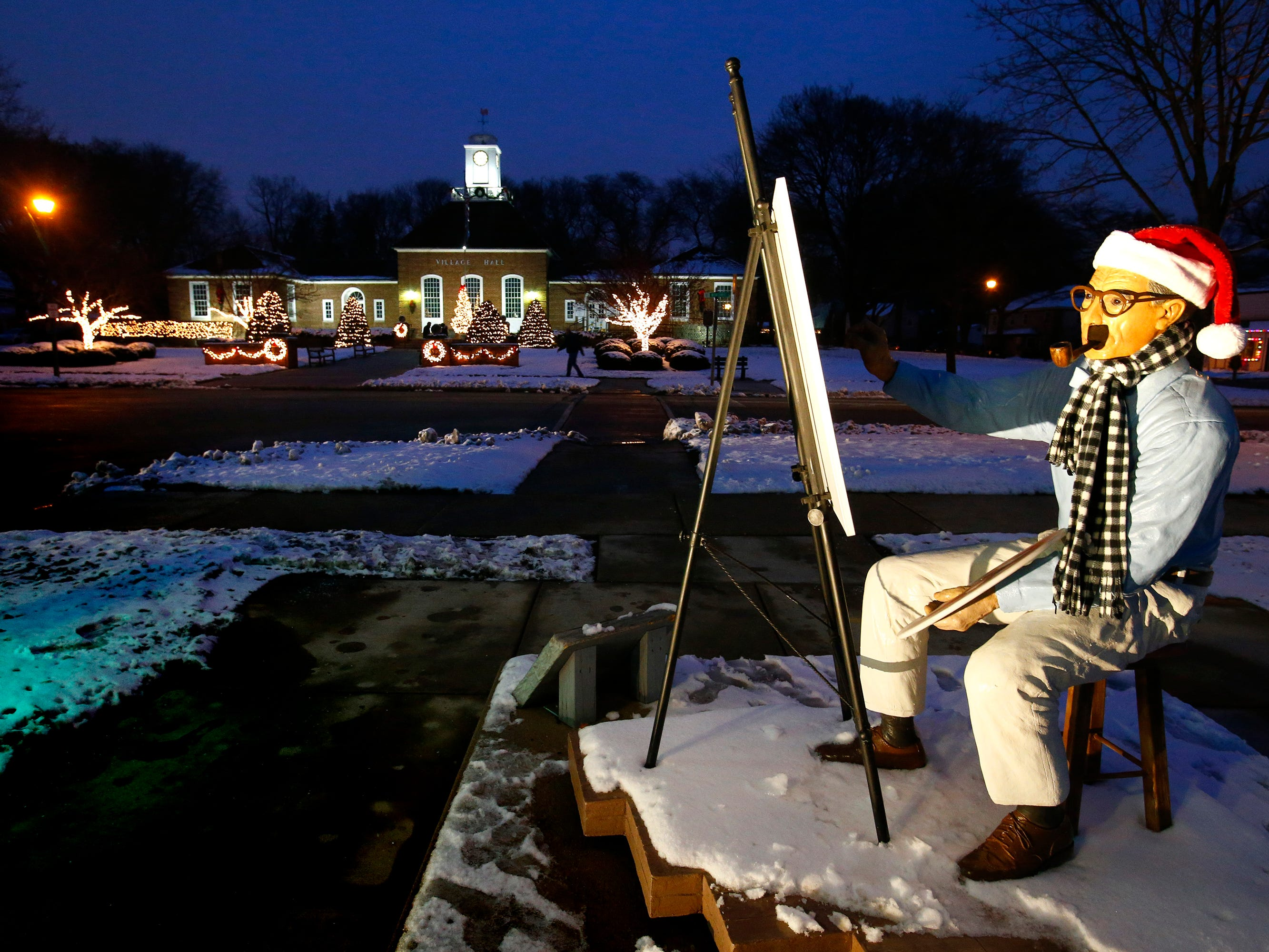 The Village's Norman Rockwell statue keeps painting during Greendale's Dickens of a Christmas Festival on Nov. 30.