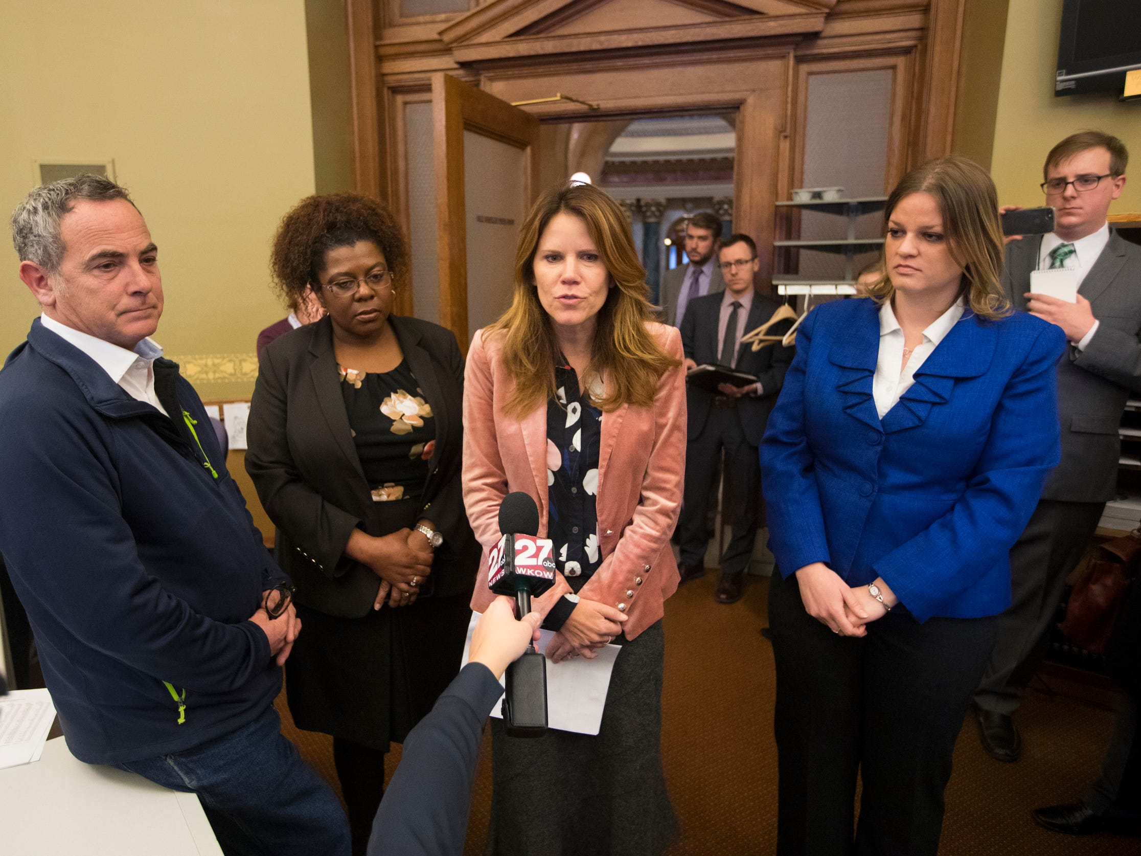 State Rep. Chris Taylor (center) is joined by fellow Democrats (from left) state Sen. John Erpenbach, Sen. LaTonya Johnson and Rep. Katrina Shankland to voice their opposition to the Legislature's lame-duck session  Monday.