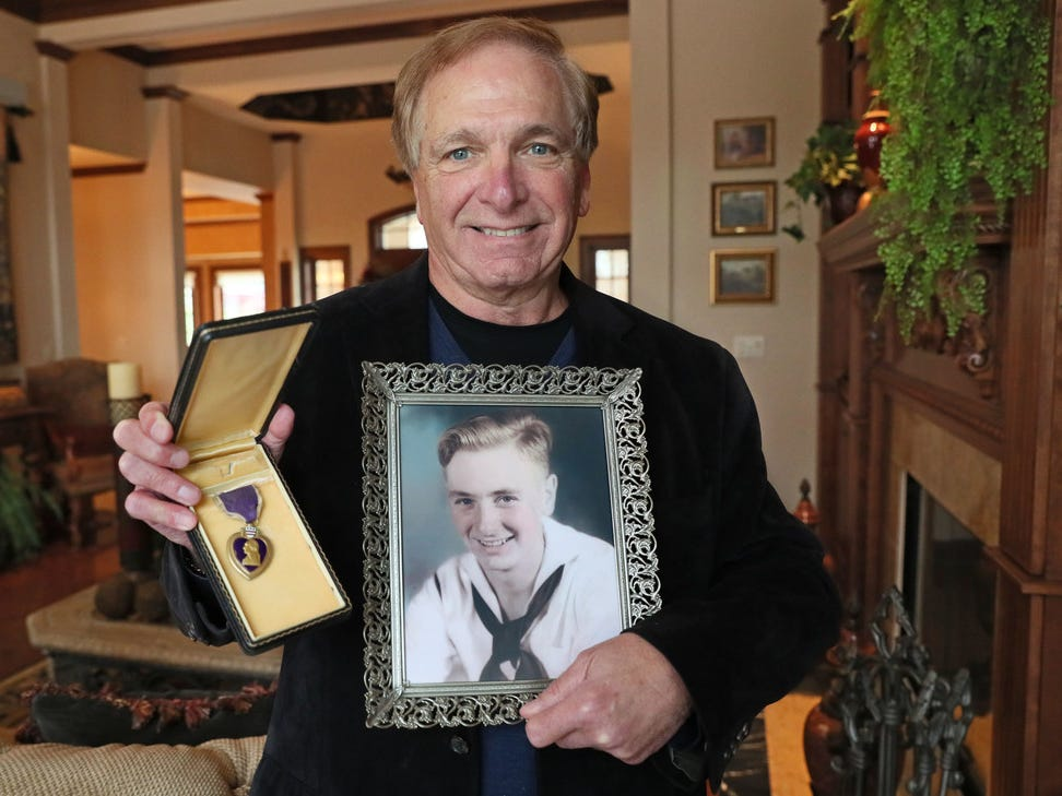 Ken Mater of Brookfield holds a photo of his mother's brother, Roy Kenneth Marin, who joined the Navy the day after the Pearl Harbor attack. Marin  was killed when the submarine USS Bullhead was sunk by the Japanese on the same day the atomic bomb was dropped on Hiroshima. It was the last ship sunk in WWII.