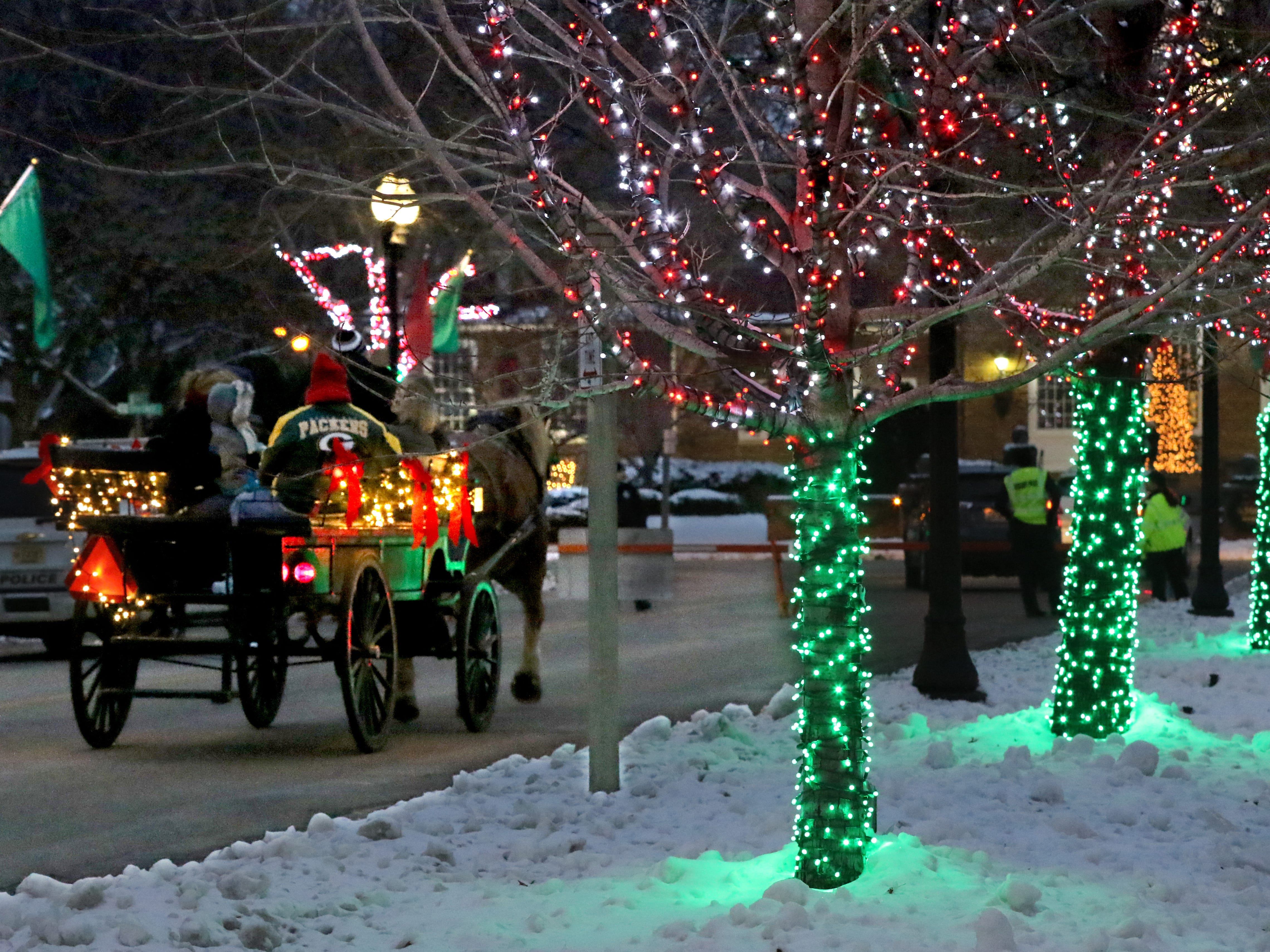 A horse-drawn wagon rolls along Broad Street during Greendale's Dickens of a Christmas Festival on Nov. 30.