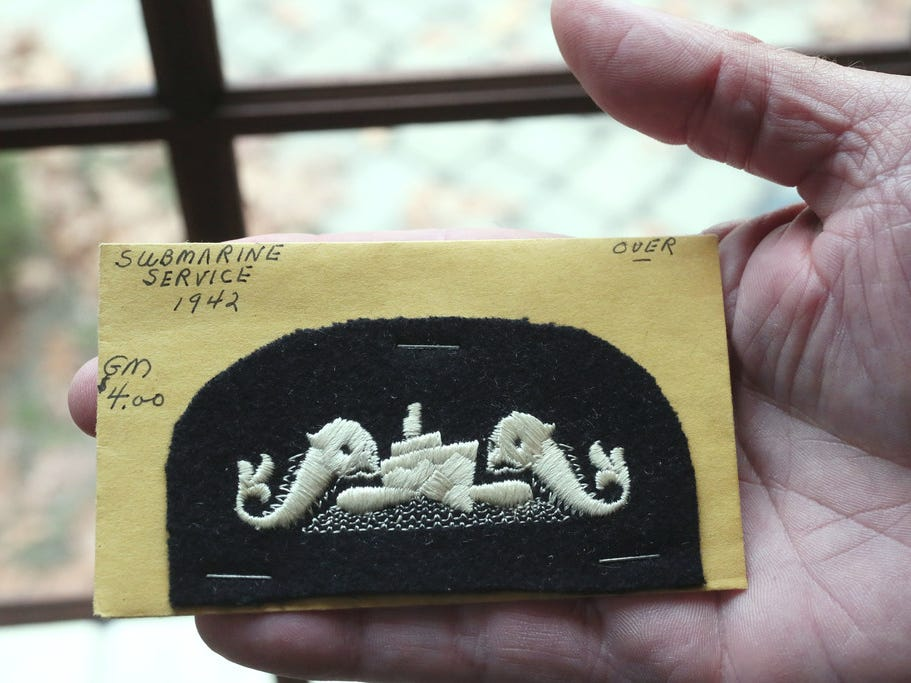 Ken Mater of Brookfield holds a World War II submarine patch similar to one worn by his uncle Roy K. Marin.