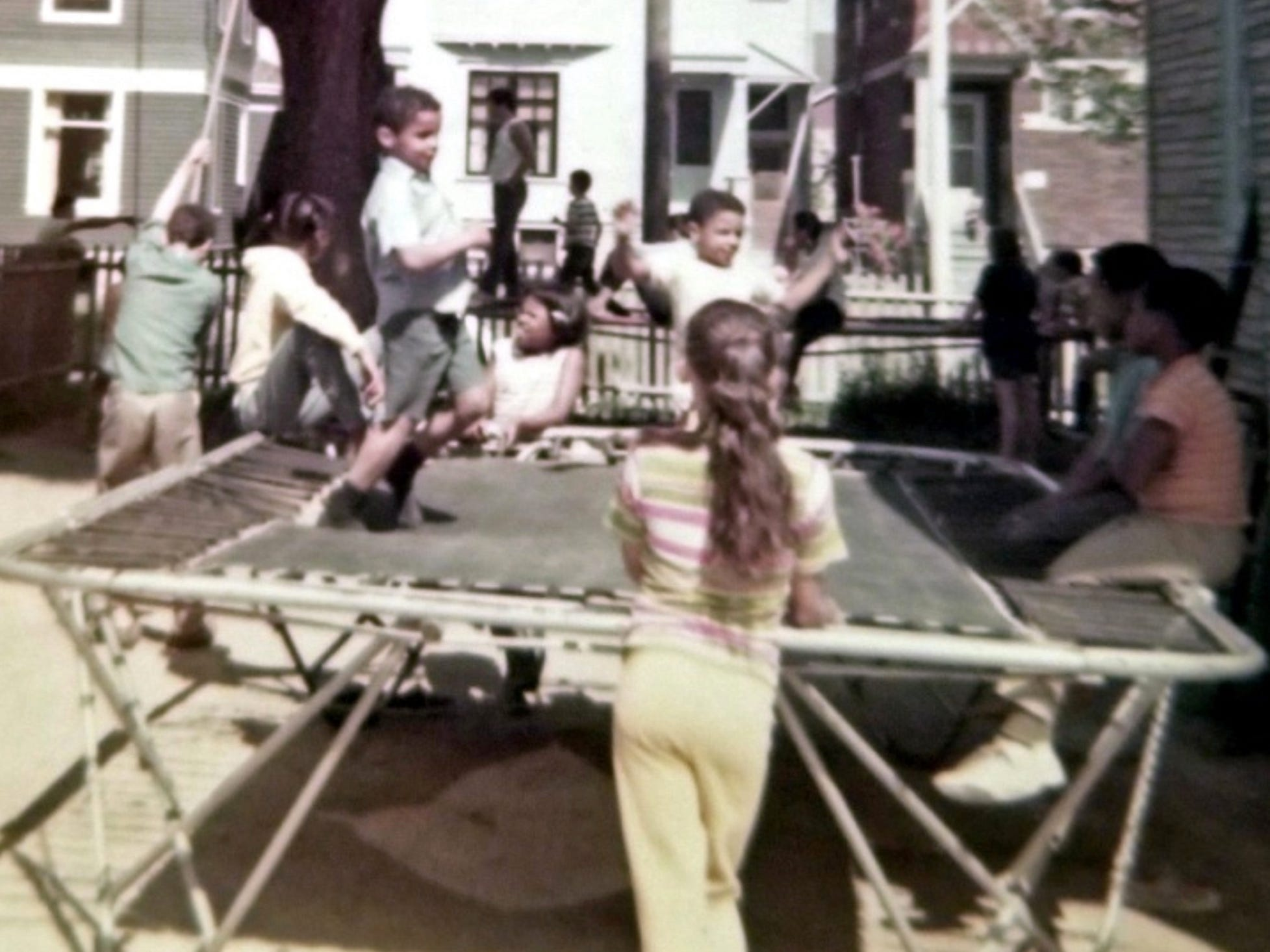 Children frolic in the backyard gymnasium of Bob Paquette's Merrill Park home in the 1970s.