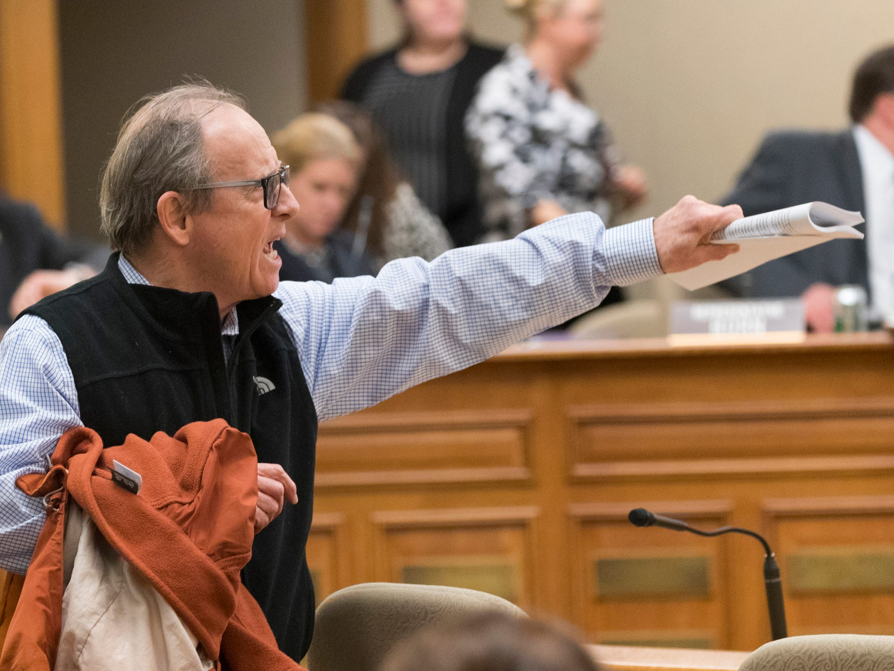A man voices his displeasure over a lame-duck session of the Joint Finance Committee Monday.