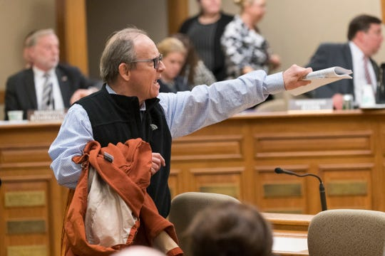 A man voice his displeasure Monday over a lame-duck session of the Joint Finance Committee.