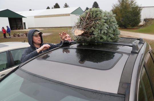 Brian and Marcia Rennicke of Grafton put their tree on their car roof at Trees For Less Nursery in Grafton in 2018.