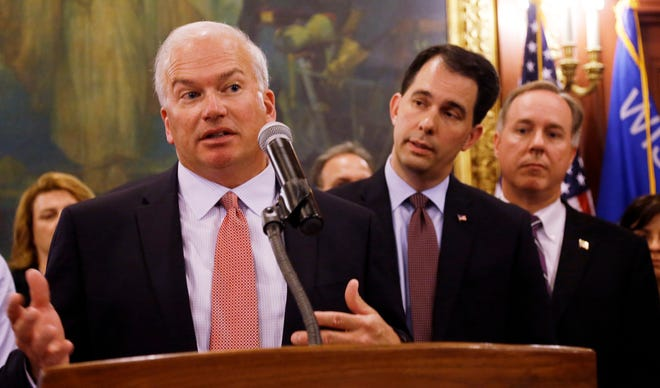 Republican Senate Majority Leader Scott  Fitzgerald (left), Gov. Scott Walker (center) and Assembly Speaker Robin Vos (right).
