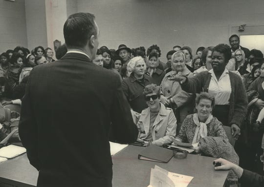 "Mothers receiving financial assistance meet with officials at the Milwaukee County welfare office to ask for special ""emergency"" grants of $25 per family member to ""provide decent, adequate Christmas for my family"" on Dec. 2, 1968. This photo was published in the Dec. 3, 1968, Milwaukee Journal."