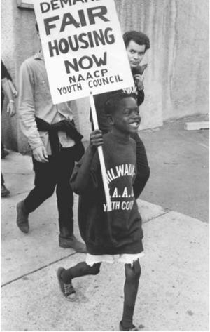 Despite violent anti-protesters, young boys like this one still marched for fair housing