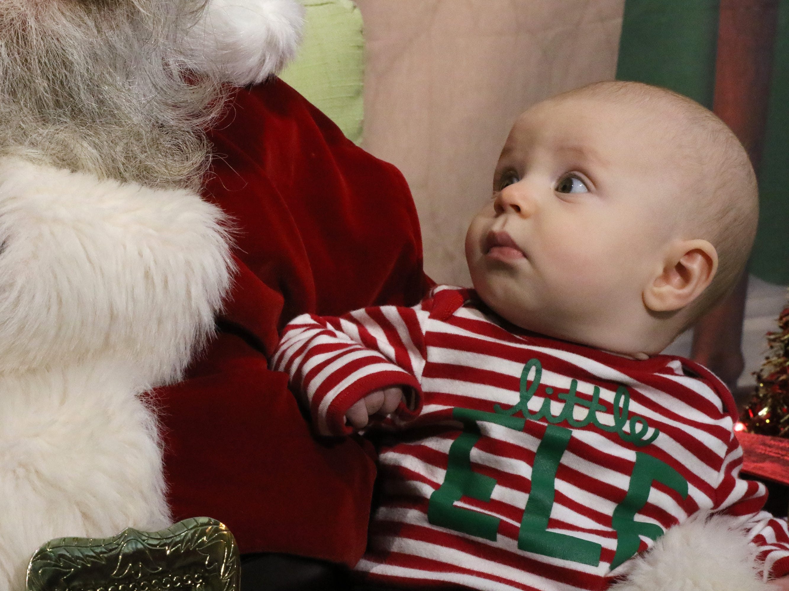 Charlie Rothe has his first visit with Santa at Gifts of Wings during Greendale's Dickens of a Christmas Festival on Nov. 30.