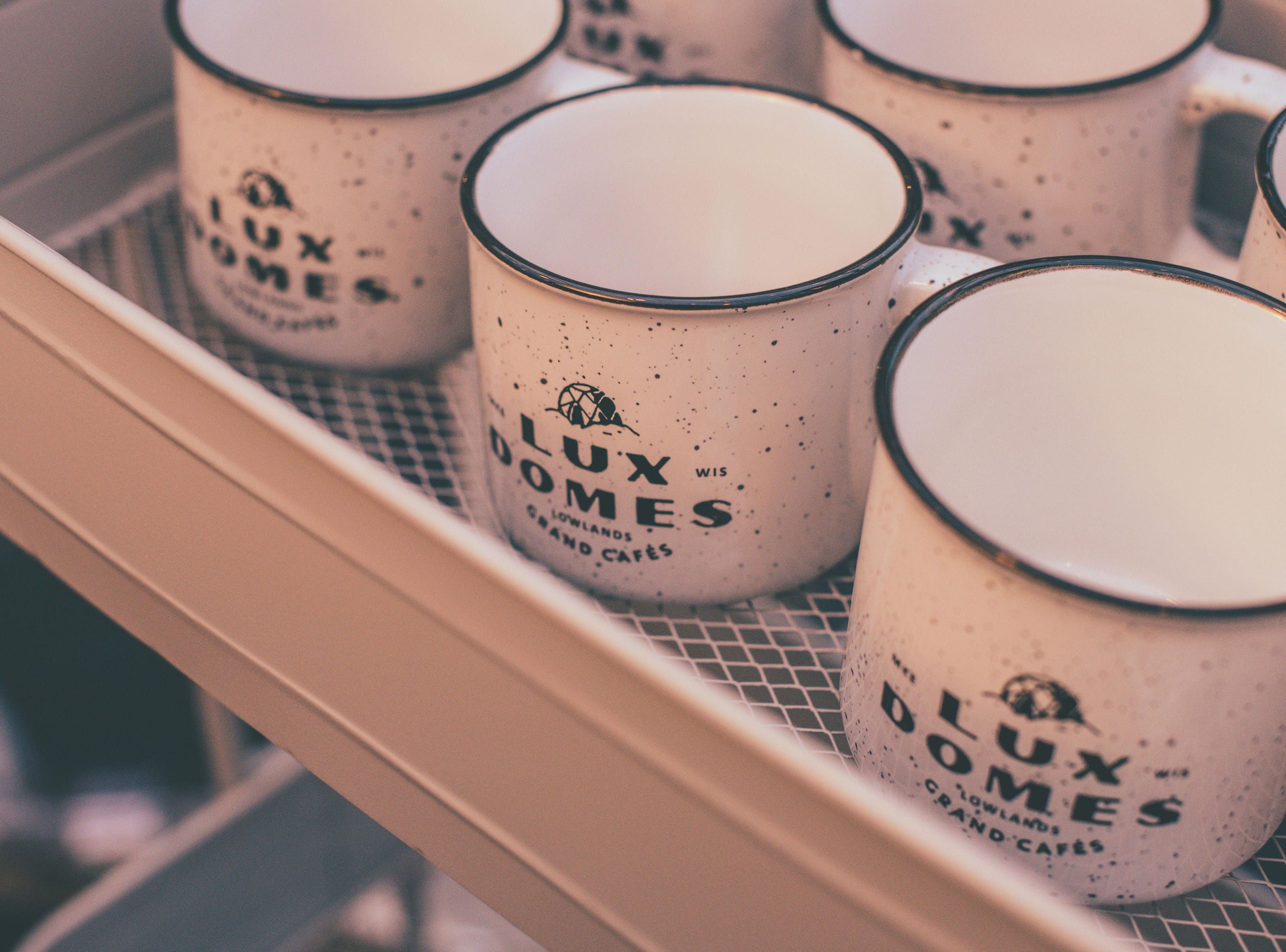 Visitors to Cafe Benelux's Lux Domes get to take home these specialty mugs after their domes experience.