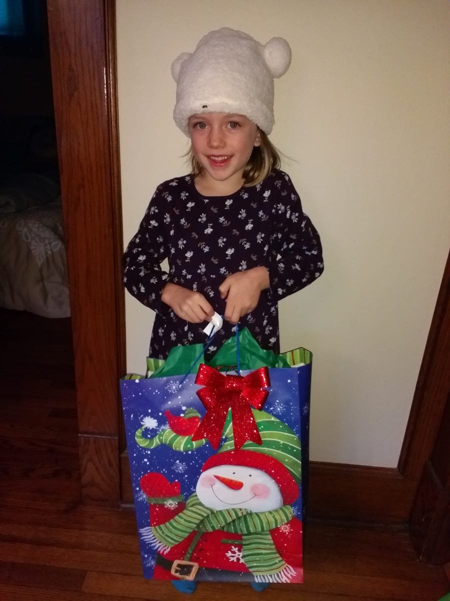 Five-year-old Harper Brown shows off the wrapped gift she's ready to give away to a child in need.