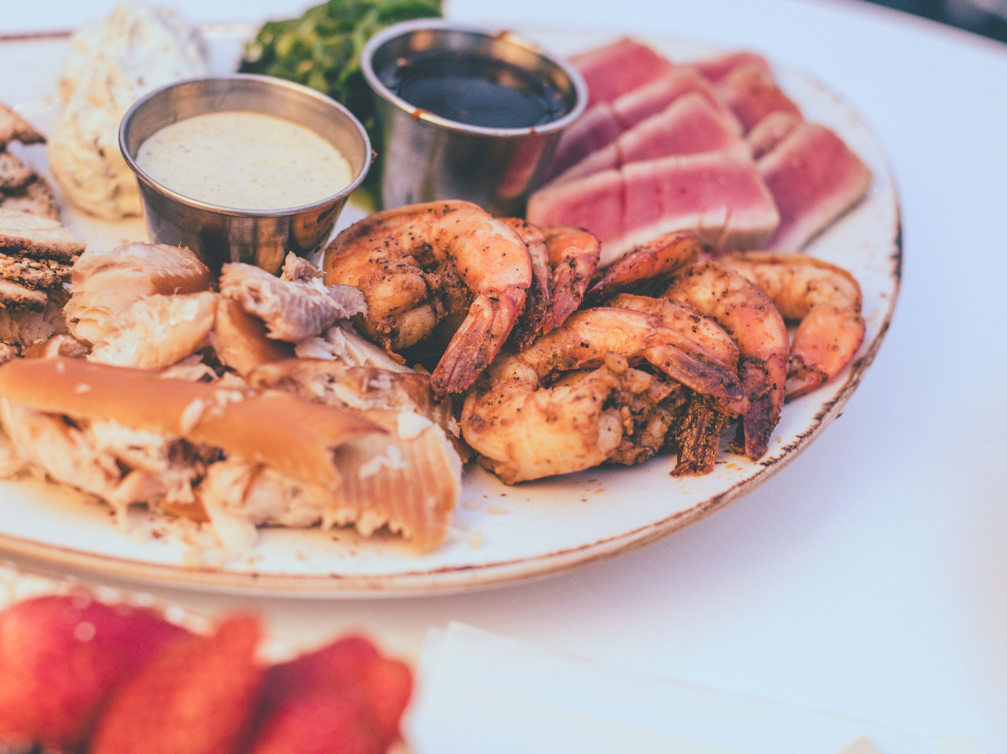 The Seafood Platter, with smoked rainbow trout, spiced shrimp, seared rare ahi tuna and more, is one of six food packages available in Cafe Benelux's Lux Domes.