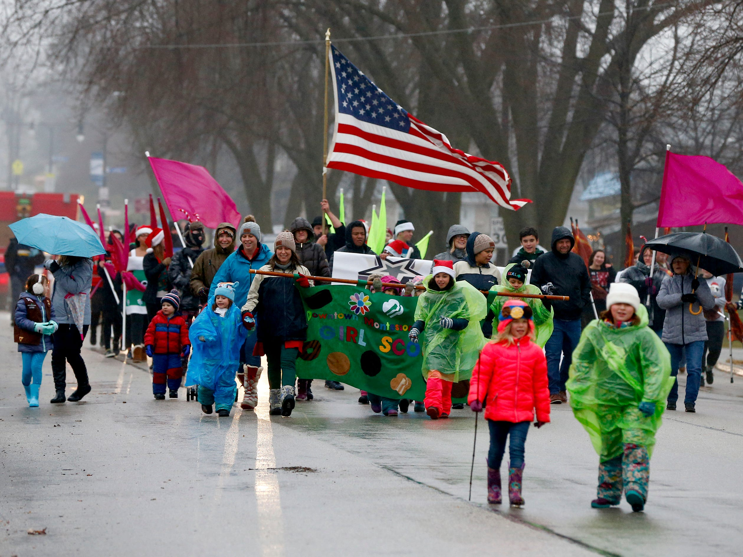 Cold rain and wind challenges marchers in the first city-sponsored St. Francis Christmas Parade on Dec. 1.