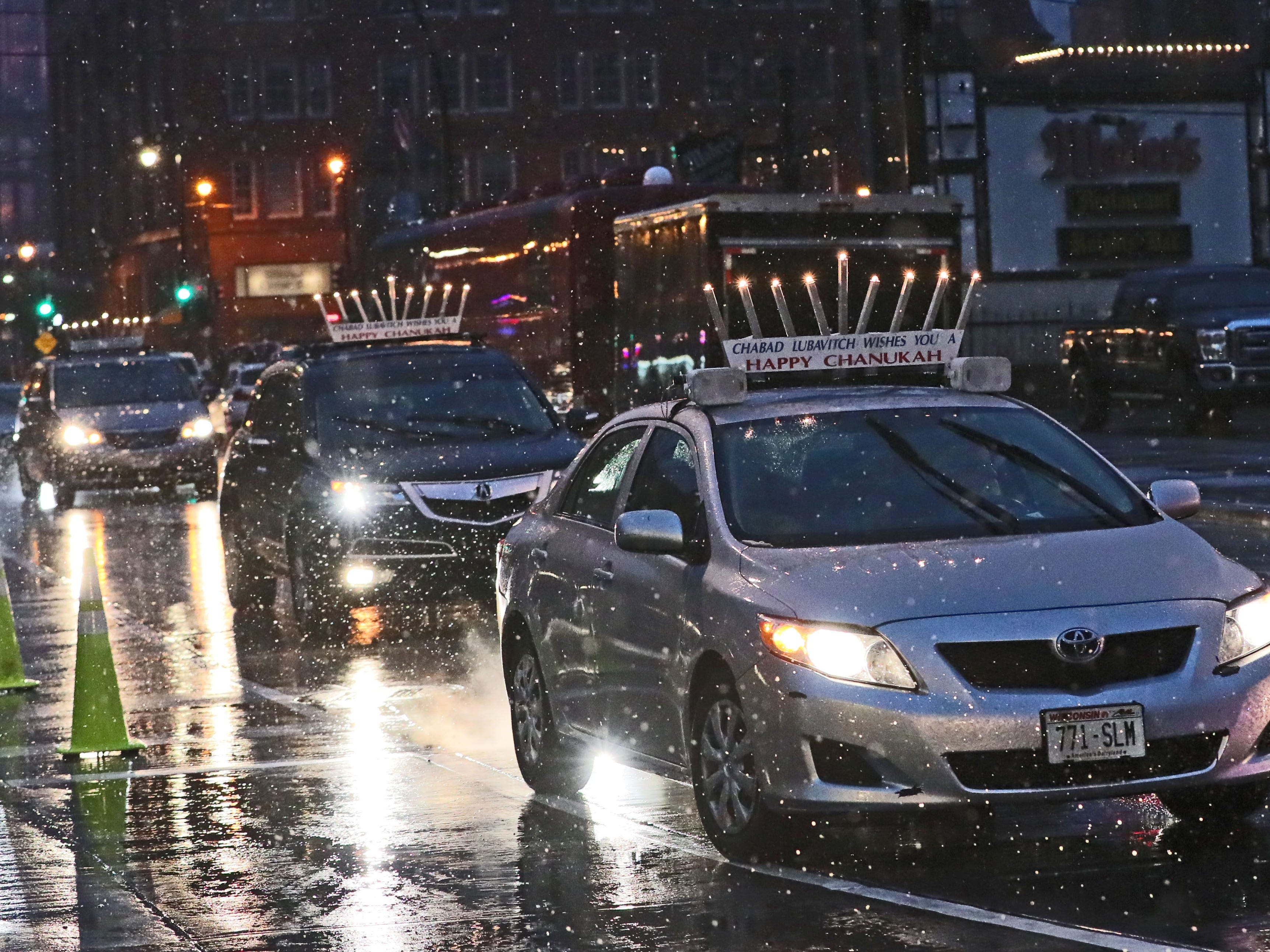 Cars with menorahs on their roofs  arrived at the event as part of the Great Menorah Parade Sunday.