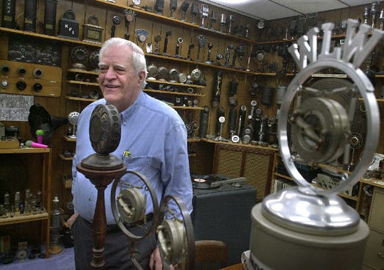 """Bob Paquette stands in his near south side microphone museum Thursday, March 28, 2002. Paquette, whose microphones have appeared in Woody Allen films as well as """"Raging Bull,"""" starring Robert DiNiro, has more than 1,000 one-of-a-kind mics in his collection, including one used in the Antarctica by Admiral Richard Byrd and one used by Adolf Hitler."""
