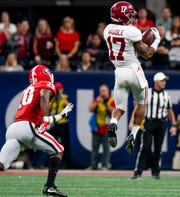 Alabama wide receiver Jaylen Waddle (17) catches a pass against Georgia in the SEC Championship Game at Mercedes Benz Stadium in Atlanta, Ga., on Saturday December 1, 2018.