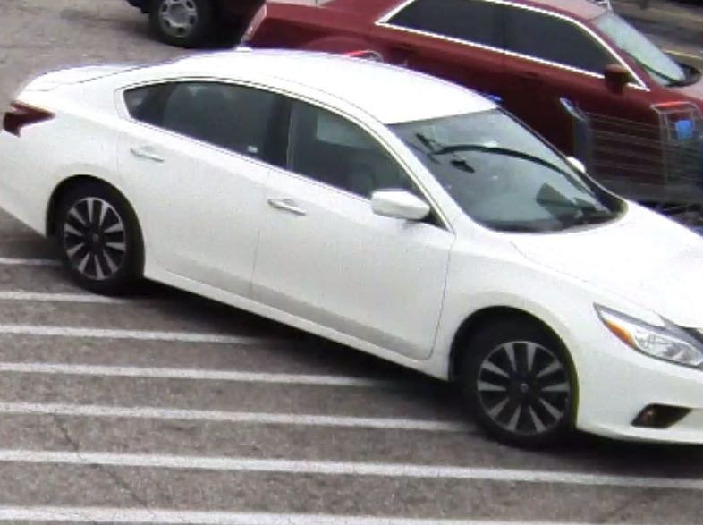 Police believe the man wanted in several credit card fraud cases was driving this white Nissan Altima.
