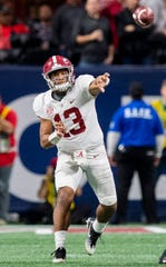 Alabama quarterback Tua Tagovailoa (13) passes against Georgia in the SEC Championship Game at Mercedes Benz Stadium in Atlanta, Ga., on Saturday December 1, 2018.