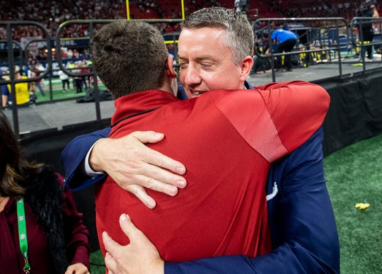 Alabama Athletic Director Greg Byrne hugs staff after Alabama wins the SEC Championship Game at Mercedes Benz Stadium in Atlanta, Ga., on Saturday December 1, 2018.