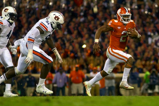 Clemson quarterback Kelly Bryant (2) runs past Auburn defenders Jeff Holland (4) and Nick Coe (91) on Sept. 9, 2017.