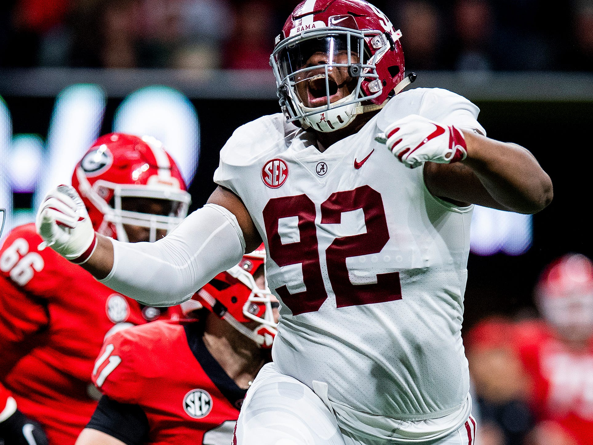 Alabama defensive lineman Quinnen Williams (92) celebrates a sack against Georgia during first half action of the SEC Championship Game at Mercedes Benz Stadium in Atlanta, Ga., on Saturday December 1, 2018.