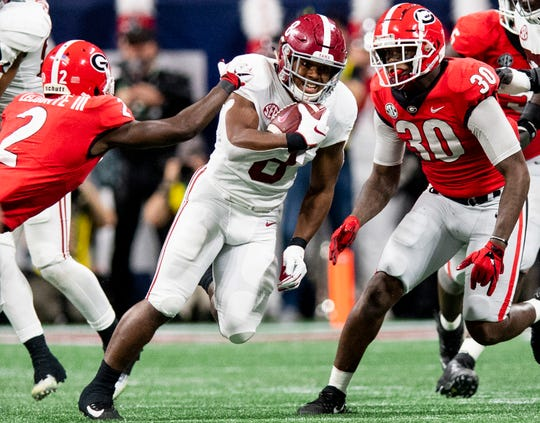 Alabama running back Josh Jacobs (8) carries the ball against Georgia during first half action of the SEC Championship Game at Mercedes Benz Stadium in Atlanta, Ga., on Saturday December 1, 2018.