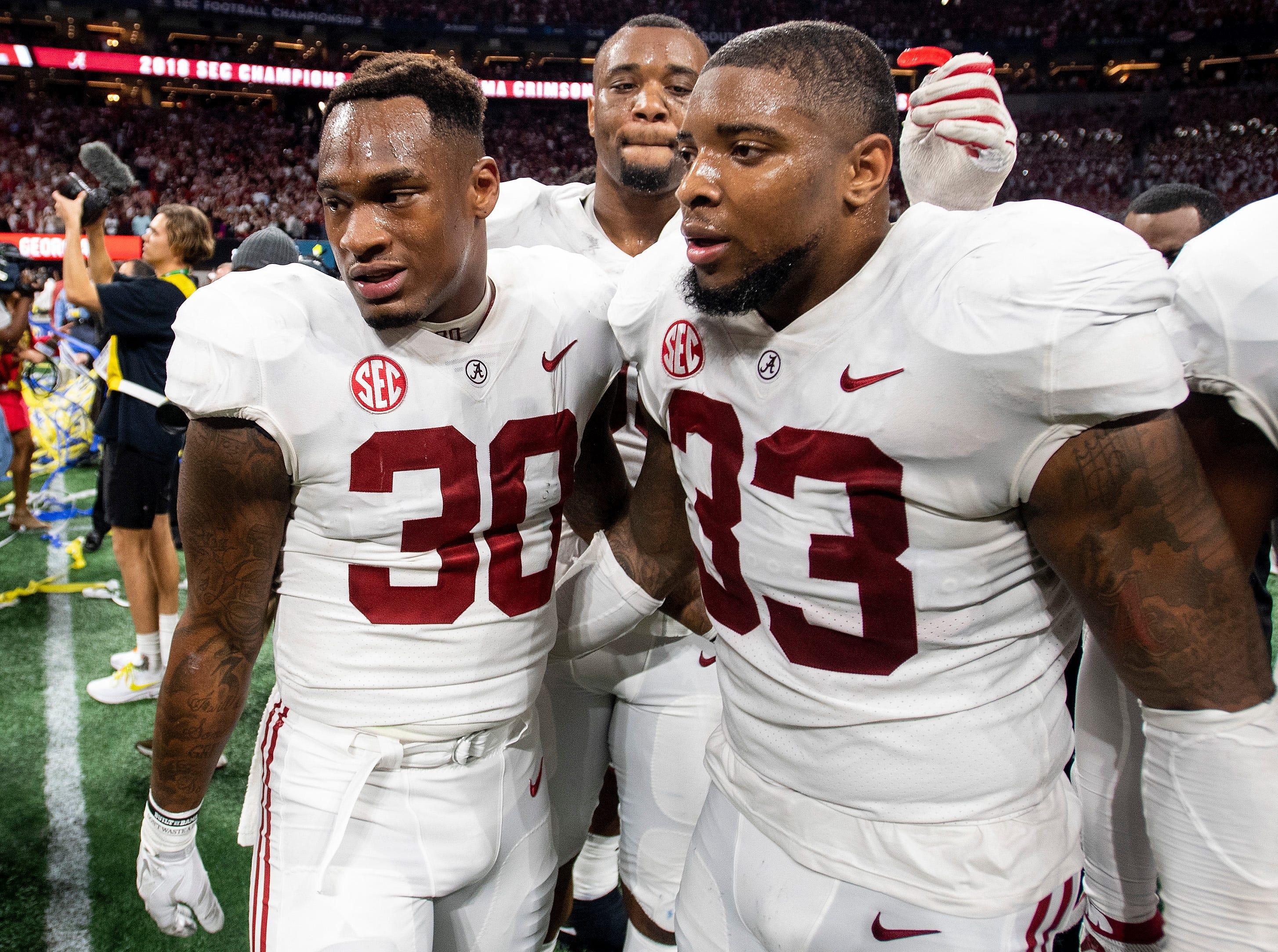 Alabama linebacker Mack Wilson (30), linebacker Anfernee Jennings (33) and defensive lineman Raekwon Davis (99) after winning the SEC Championship Game at Mercedes Benz Stadium in Atlanta, Ga., on Saturday December 1, 2018.