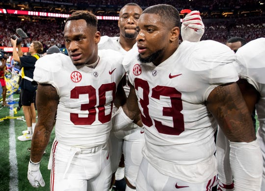 Alabama linebacker Mack Wilson (30), linebacker Anfernee Jennings (33) and defensive lineman Raekwon Davis (99) after winning the SEC Championship Game at Mercedes Benz Stadium in Atlanta, Ga., on Saturday December 1, 2018.