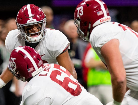 Alabama quarterback Tua Tagovailoa (13) shouts directions from under center against Georgia during first half action of the SEC Championship Game at Mercedes Benz Stadium in Atlanta, Ga., on Saturday December 1, 2018.