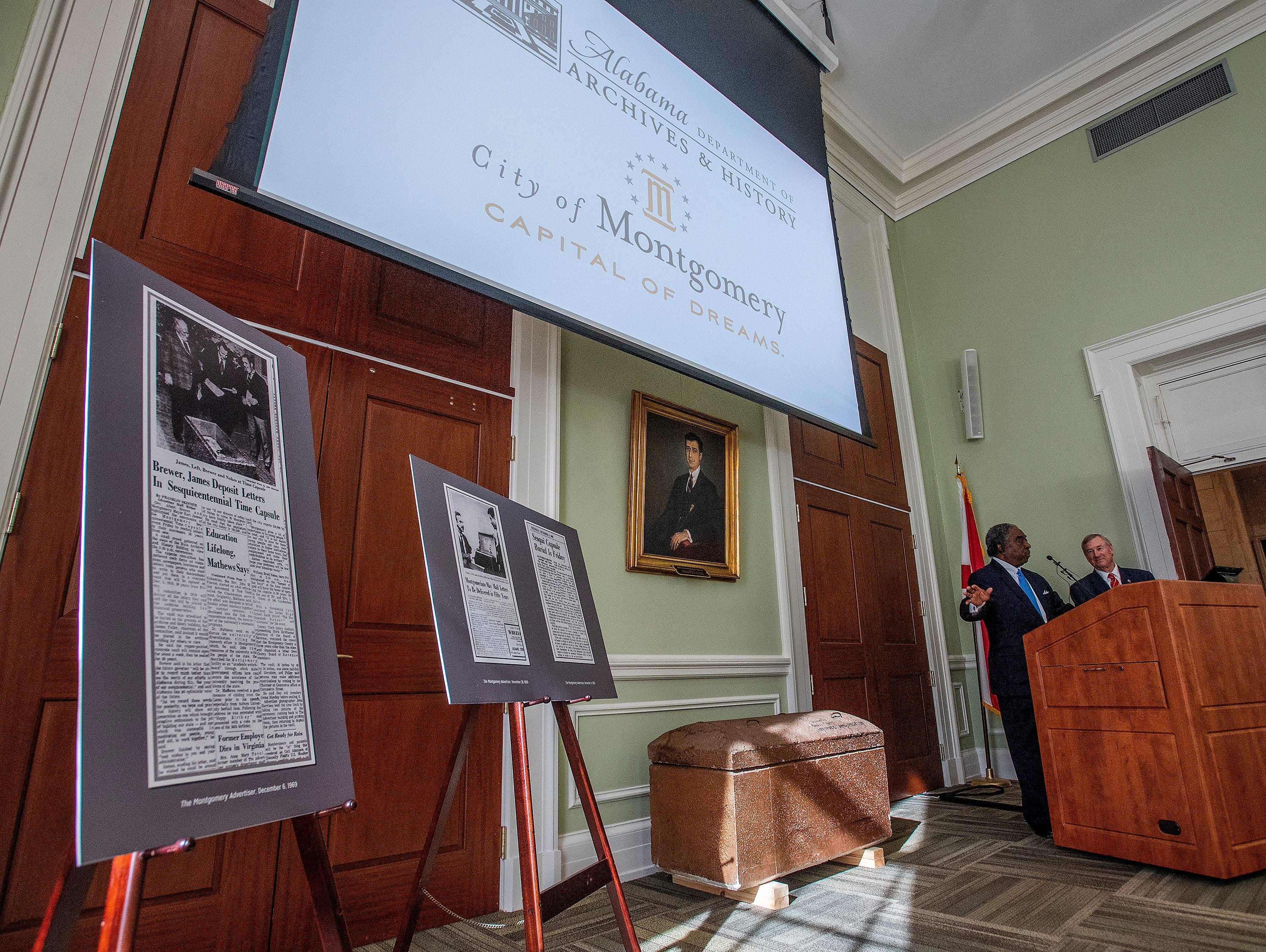Judge Charles Price, of the Chamber of Commerce, and Mayor Todd Strange speak as the City of Montgomery and the Alabama Department of Archives and History unveiled, during a ceremony at the Archives on Monday December 3, 2018, the 1969 time capsule that will be opened on the 200th anniversary of the incorporation of Montgomery on December 3, 2019.