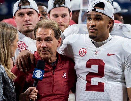Alabama head coach Nick Saban and Alabama quarterback Jalen Hurts (2) are interviewed after defeating Georgia in the SEC Championship Game at Mercedes Benz Stadium in Atlanta, Ga., on Saturday December 1, 2018.
