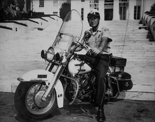 Then Montgomery Police Officer Leroy Pierce is shown on his police motorcycle in the 1950's.
