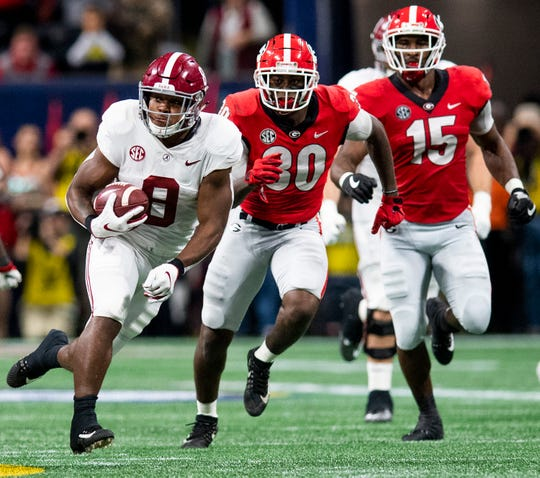 Alabama running back Josh Jacobs (8) breaks for a big gain against Georgia during first half action of the SEC Championship Game at Mercedes Benz Stadium in Atlanta, Ga., on Saturday December 1, 2018.