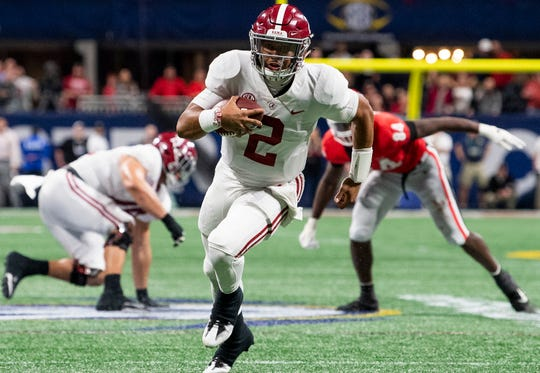 Alabama quarterback Jalen Hurts (2) carries for the go ahead touchdown against Georgia in the SEC Championship Game at Mercedes Benz Stadium in Atlanta, Ga., on Saturday December 1, 2018.