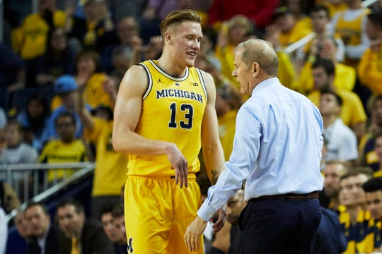Michigan head coach John Beilein talks to forward Ignas Brazdeikis (13) during a game against North Carolina on Nov. 28, 2018, in Ann Arbor, Mich.