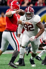 Alabama defensive lineman Quinnen Williams (92) pressures Georgia quarterback Jake Fromm (11) during first half action of the SEC Championship Game at Mercedes Benz Stadium in Atlanta, Ga., on Saturday December 1, 2018.