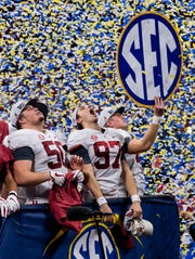 Alabama players celebrate winning the SEC Championship Game at Mercedes Benz Stadium in Atlanta, Ga., on Saturday December 1, 2018.