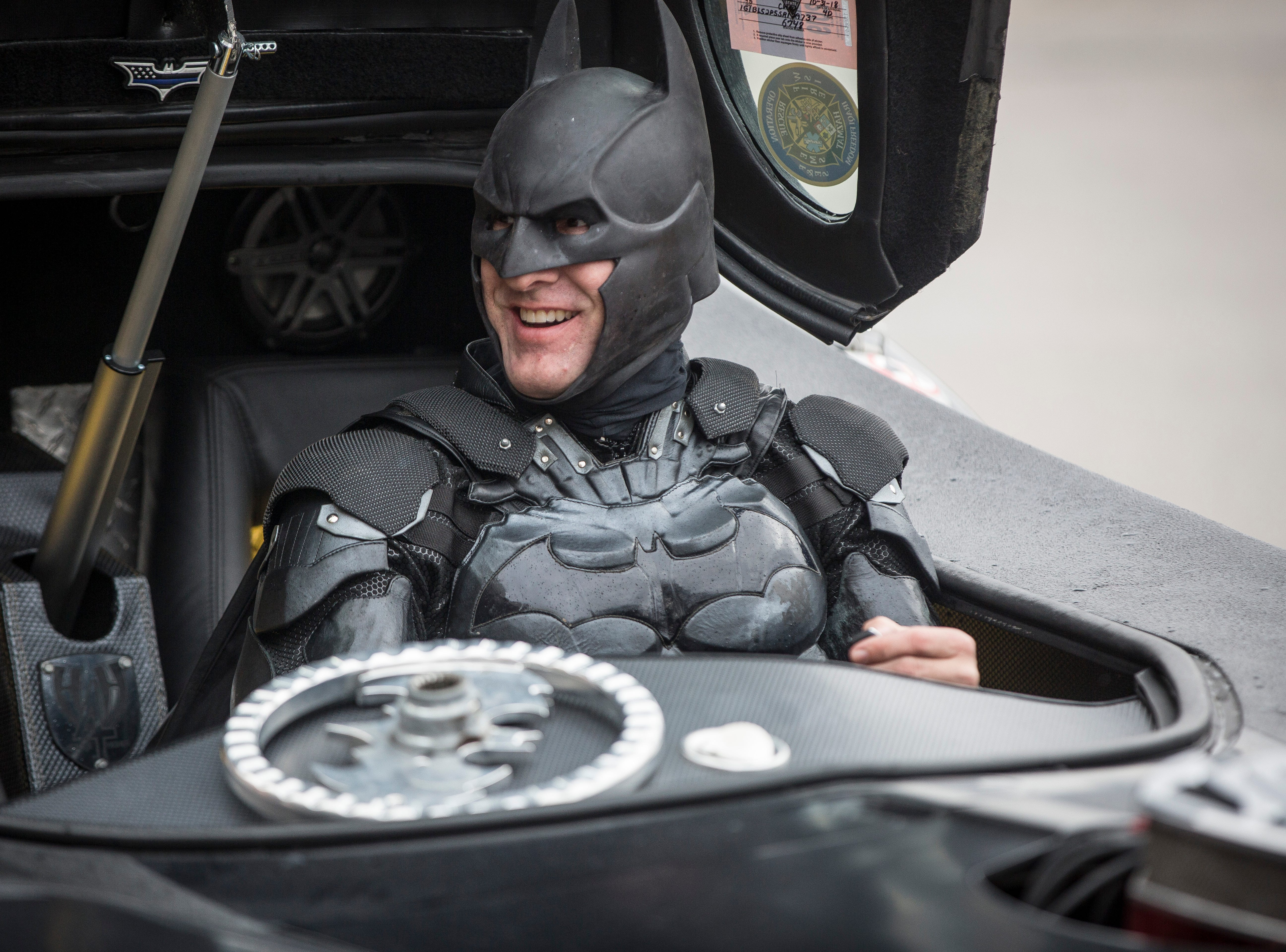John Buckland with the H4H Foundation dressed Batman and his Batmobile pull into Albany Elementary on Monday to visit Christian Daugherty, an Albany boy who has been battling cancer.