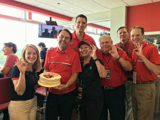Ball State trustees (from left) Marlee Jacocks, Wayne Estopinal, Rick Hall, Jean Ann Harcourt, Mike McDaniel and Tom Bracken, along with President Geoffrey S. Mearns, celebrate Estopinal's birthday at homecoming in 2017. Estopinal died in a plane crash Nov. 30, 2018, at age 63.